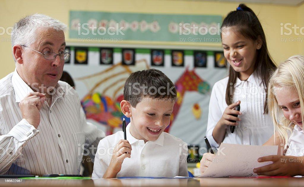 junior school: pupils enjoying learning stock photo