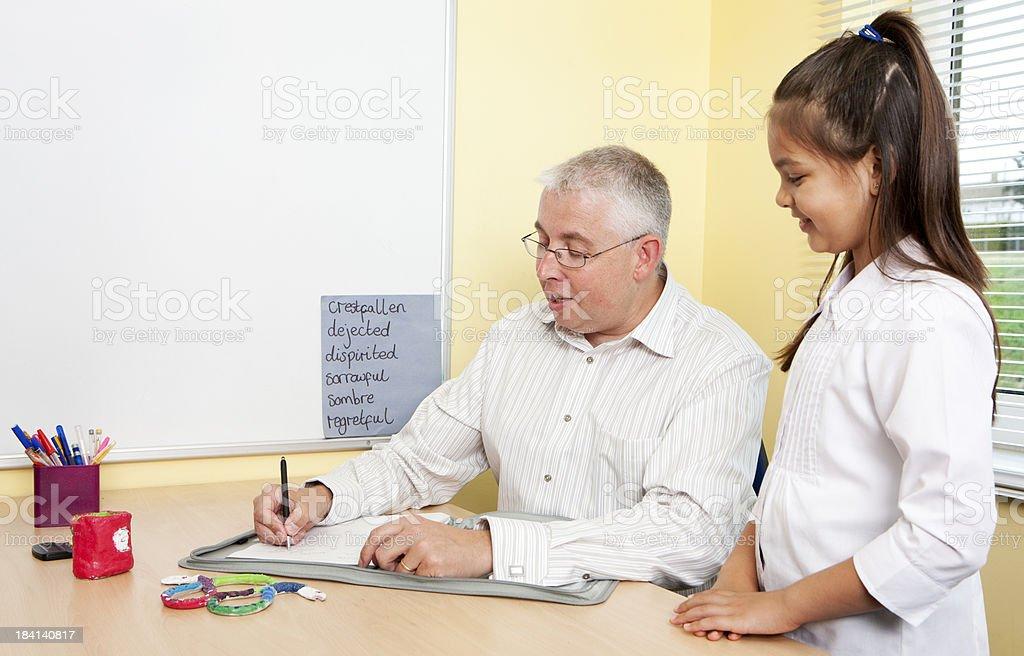 junior school teacher grading schoolgirls work stock photo more