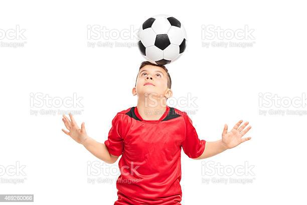Junior soccer player wearing red shirt joggling with a soccerbal picture id469260066?b=1&k=6&m=469260066&s=612x612&h=nlqhnqjc8c3rml51wtv325cykqx1jo6 pc5vp8mi8rw=
