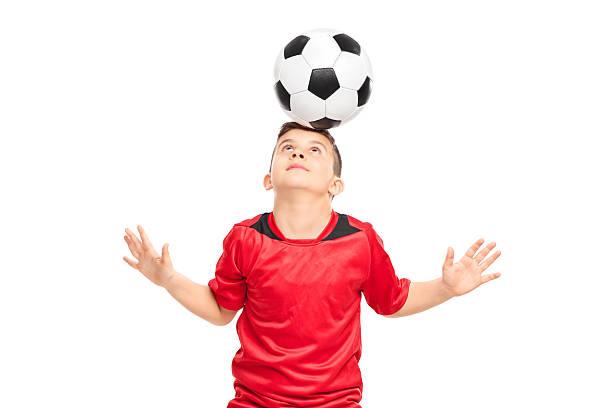 Junior soccer player wearing red shirt joggling with a soccerbal picture id469260066?b=1&k=6&m=469260066&s=612x612&w=0&h=cuo2lc27mi5zad1ap3nvshsqship txhxp2epleel6s=