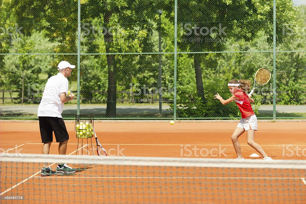 Junior tennis player in training royalty-free stock photo