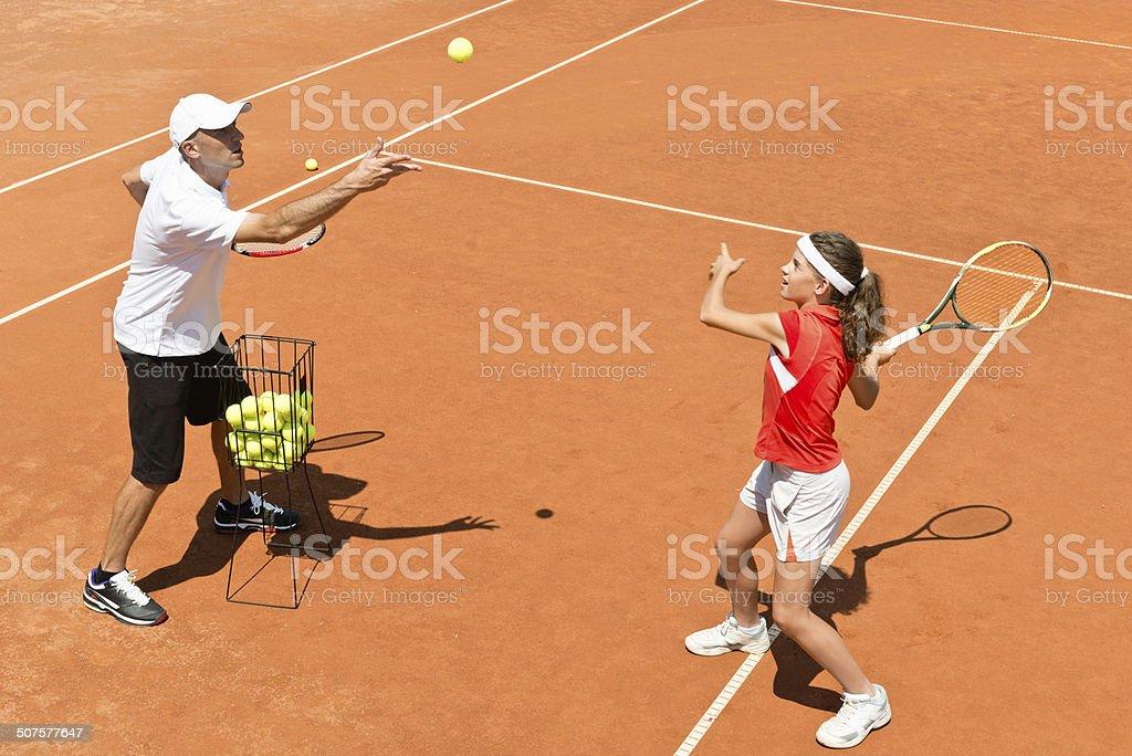 Junior tennis player in training stock photo