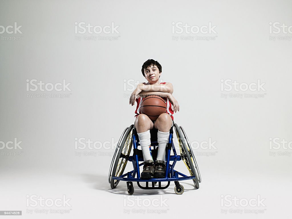 Junior wheelchair basketball player stock photo