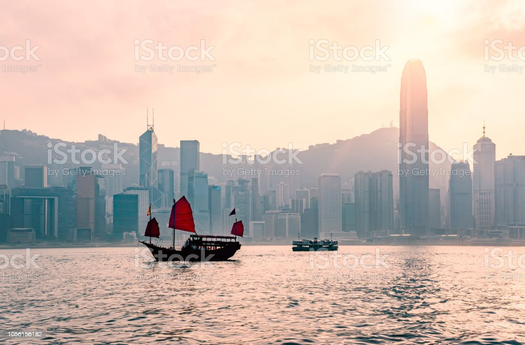 Junk boat in Hong Kong at Victoria harbour in the evening stock photo