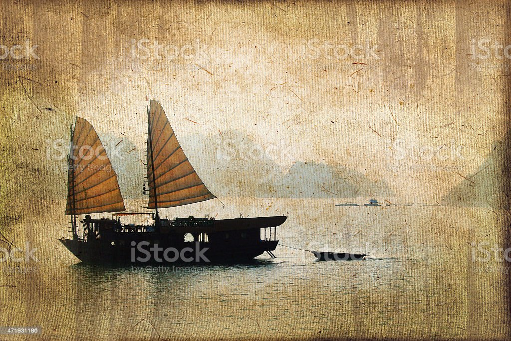 Junk boats in Halong Bay, Vietnam, vintage dark sepia process stock photo