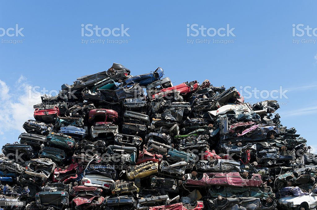 Junk cars crushed and stacked in a scrap yard stock photo
