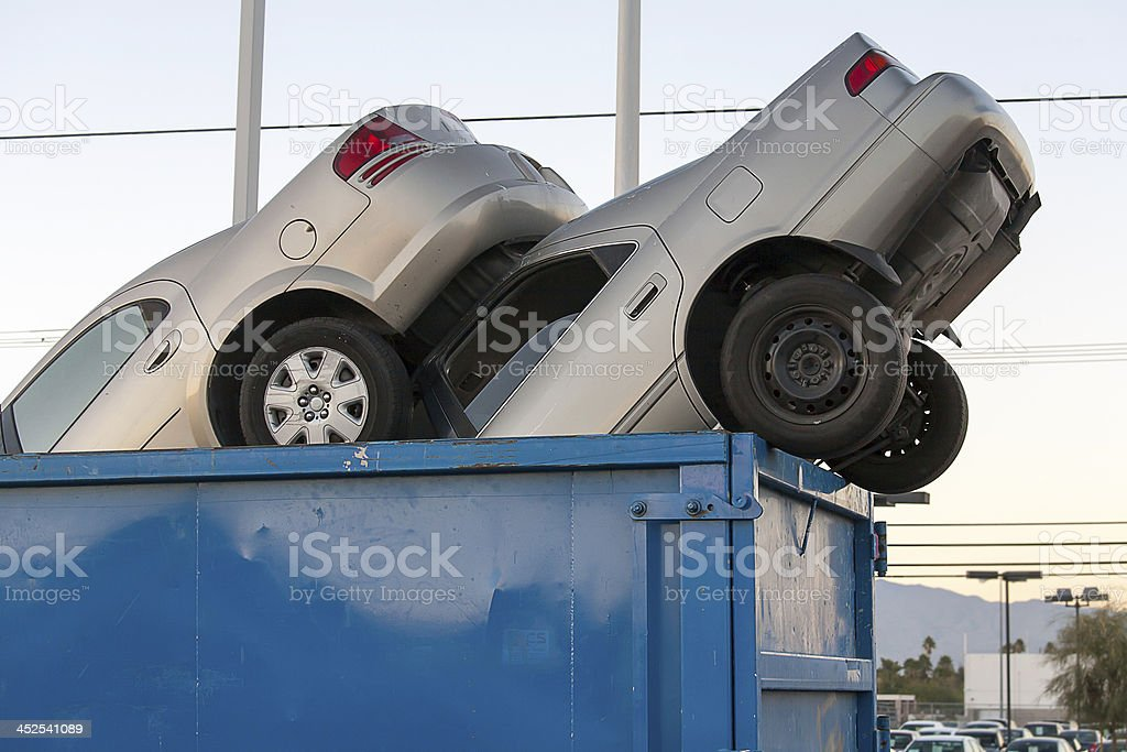 Junk cars in dumpster cash for clunkers stock photo