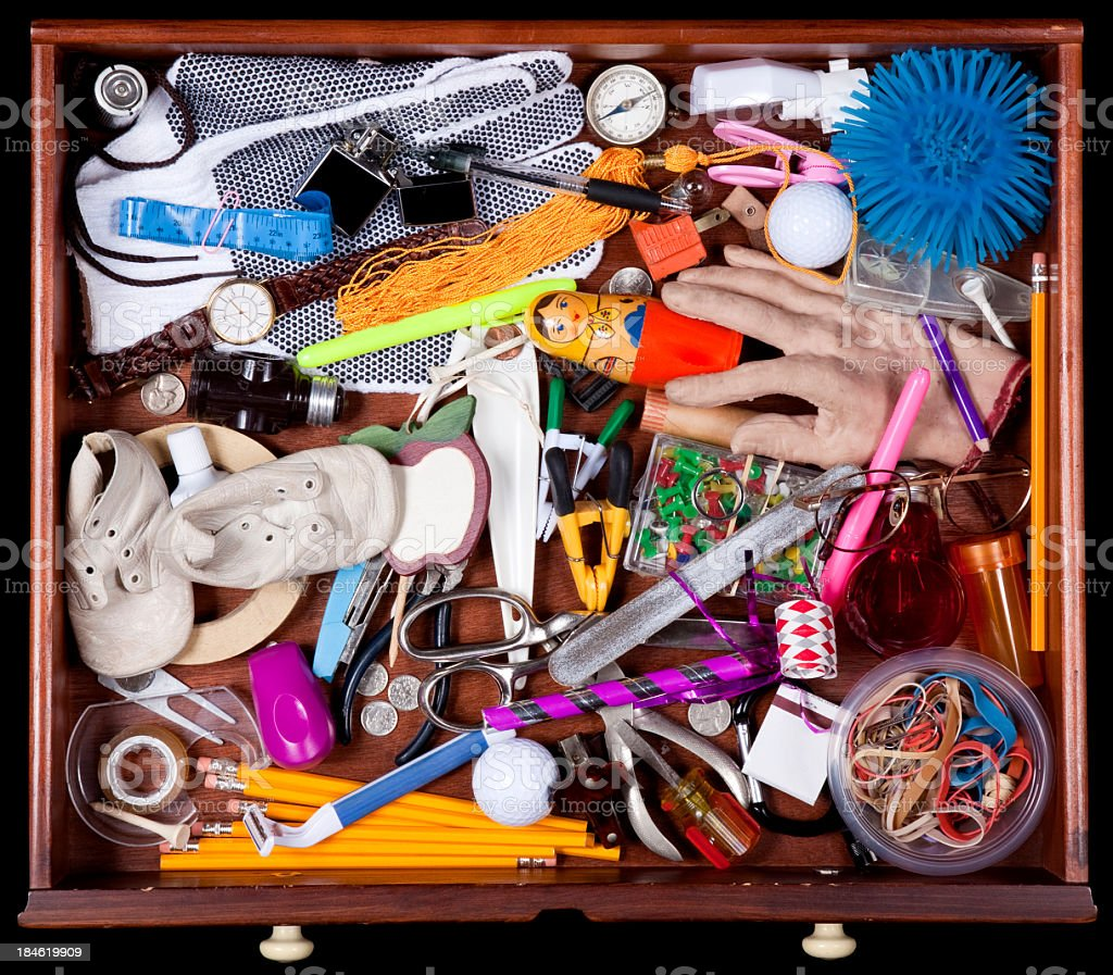 Junk Drawer with many miscellaneous objects stock photo
