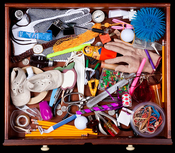 junk drawer with many miscellaneous objects - 過時的 舊式 個照片及圖片檔