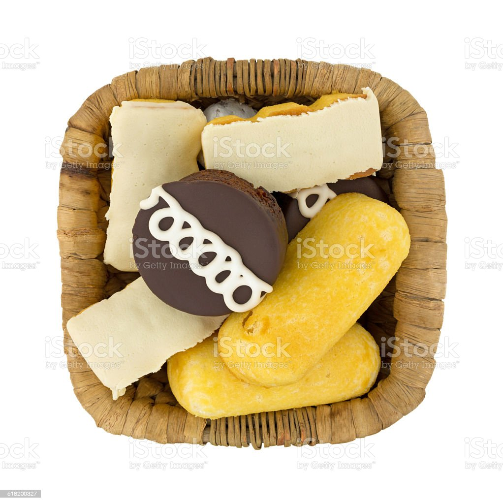 Junk food cakes and donuts in a basket stock photo