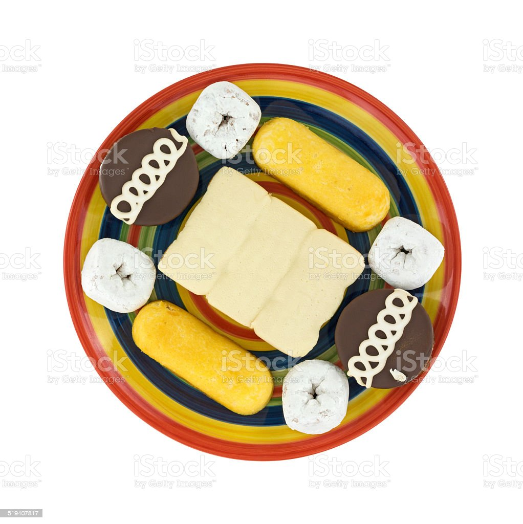 Junk food cakes and donuts on plate stock photo