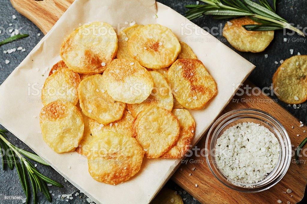 Junk food from potato chips and sea salt, top view stock photo
