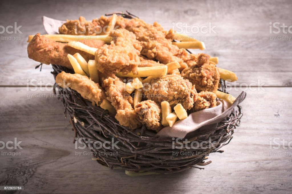 Junk food in the basket stock photo