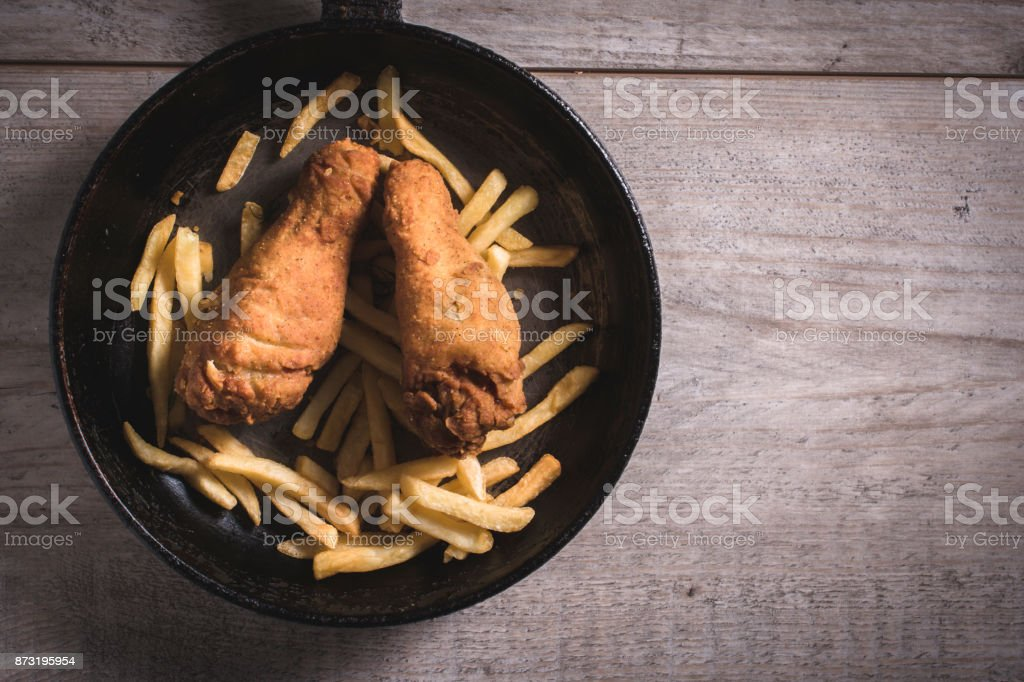 Junk food in the pan stock photo