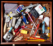Drawer with many miscellaneous objects.