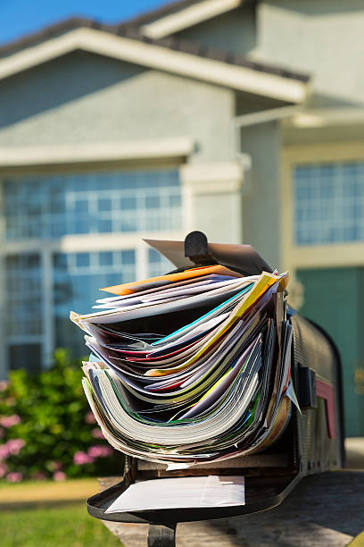 Junk mail Mail box full of junk mails full stock pictures, royalty-free photos & images