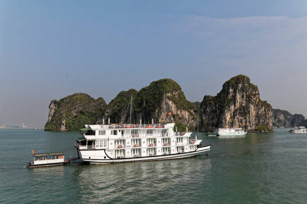 Junk ship sailing on Ha long bay in the afternoon
