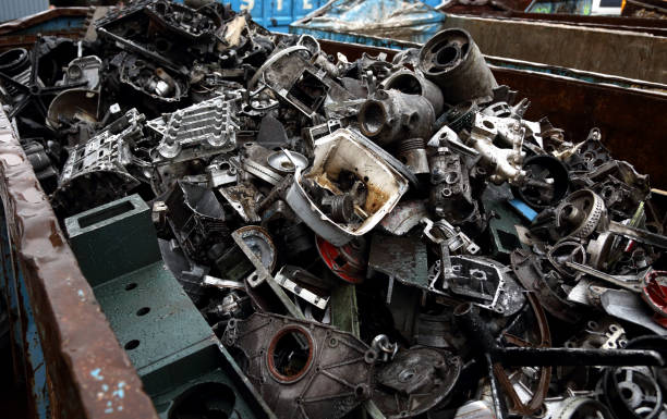 Junk yard with heap of metal waste stock photo