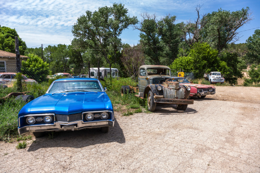 Orderville, USA - July 15, 2008: junk yard with old beautiful oldtimers on the route 89 on July 15, 2008 in Orderville, USA. America is a spot for european classic car hunters.