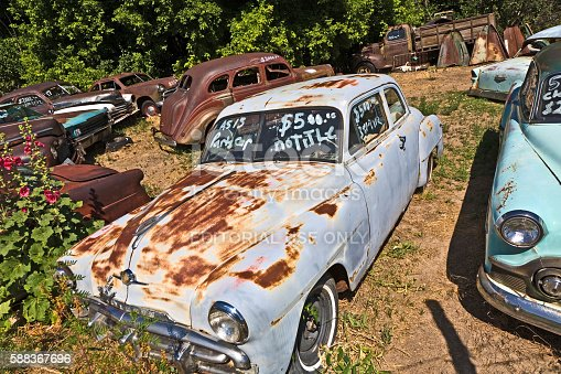 Orderville, United States - July 17, 2008: junk yard with old beautiful oldtimers on the route 89  in Orderville, USA. America is a spot for european classic car hunters.