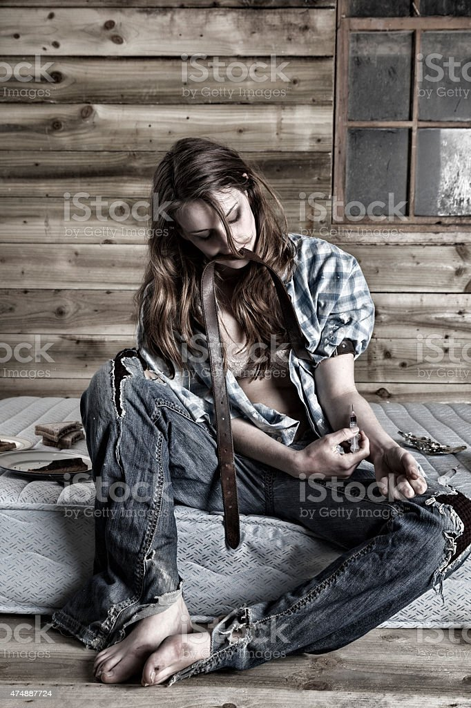 Junkie In A Squat Injecting Drugs stock photo