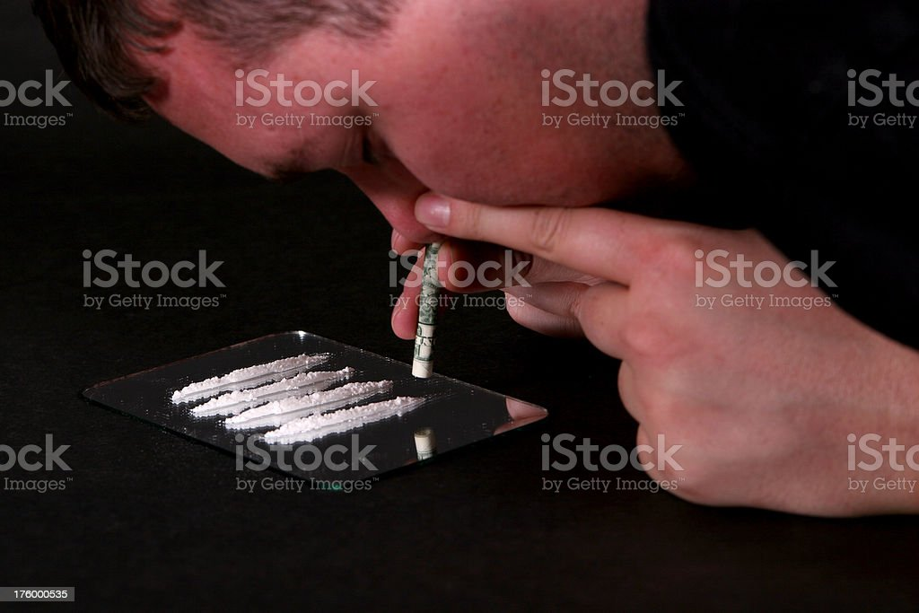 Junkie series: Snorting coke 3 (color) royalty-free stock photo
