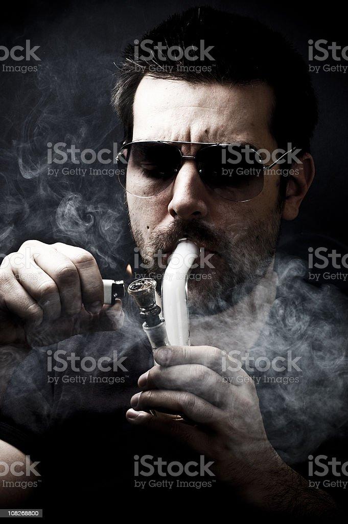 junkie smoking bong, stock photo