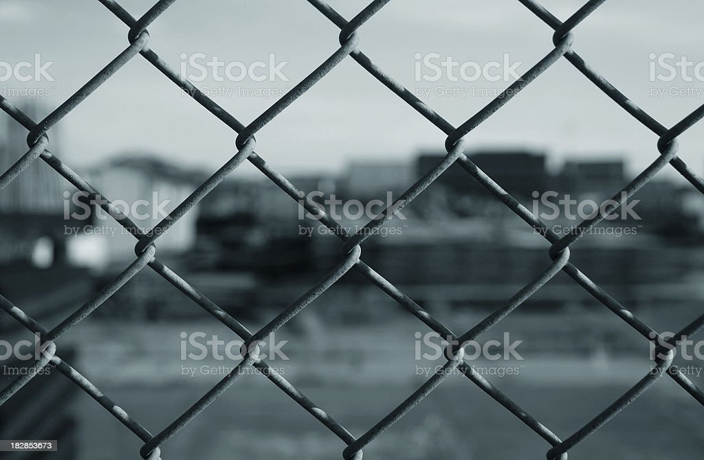 Junkyard behind wire mesh royalty-free stock photo