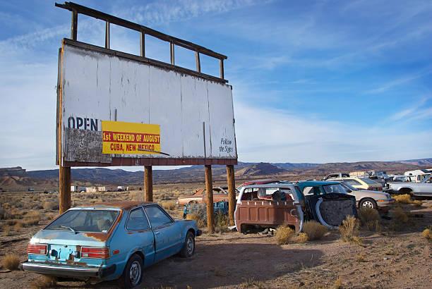 junkyard billboard desert landscape and sky stock photo