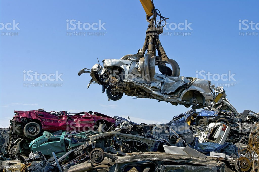 Junkyard picking up car stock photo