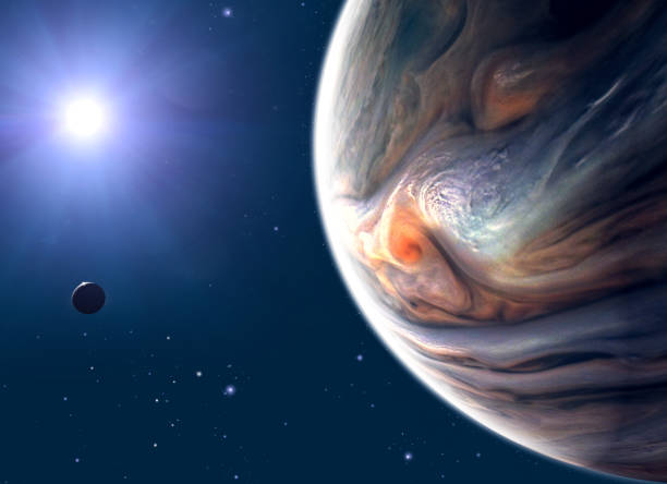 Jupiter and moon, satellite view of the planet and sun. View of a satellite orbiting the planet stock photo