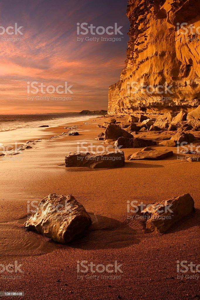 Jurassic Coast Chalk Cliff Along Beach at Sunset stock photo