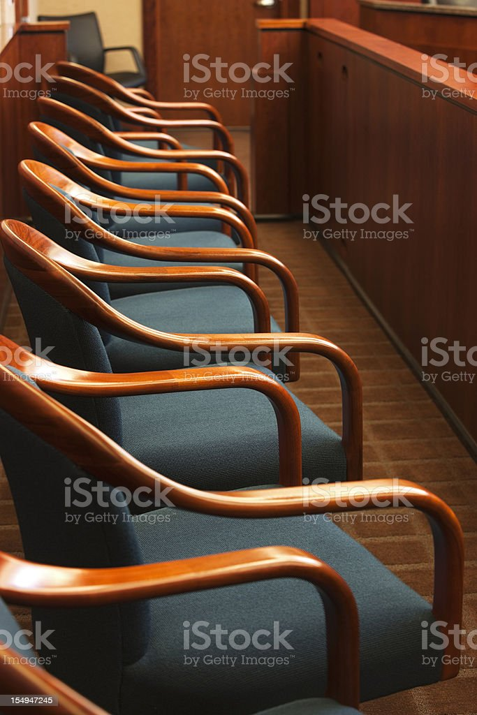 Juror's row in a court room. Juror's row in a court room. Authority Stock Photo