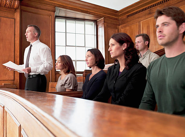 Jury sitting in courtroom stock photo