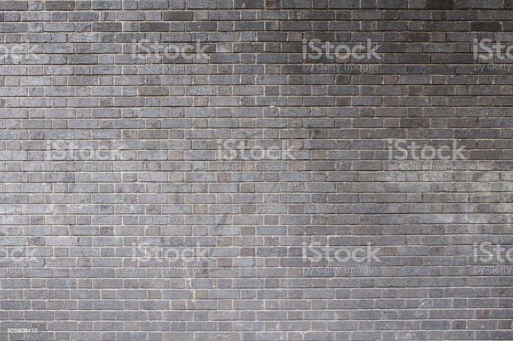 Just a gray, brick wall in London, UK stock photo