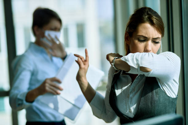 Just a second please, this cough is catching me! stock photo