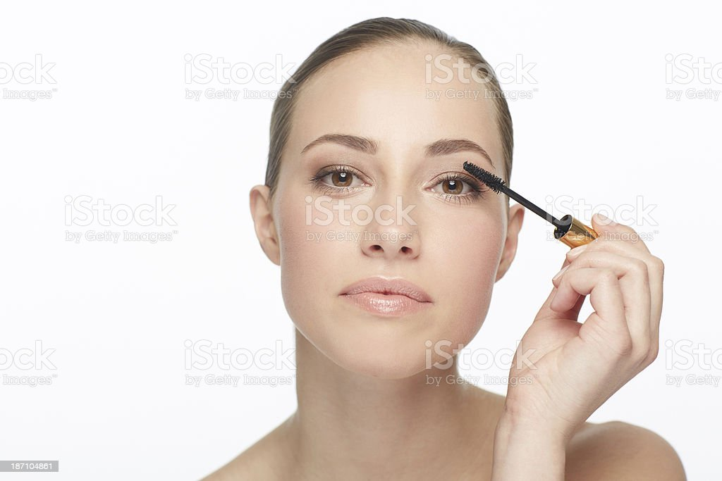 Just adding at touch to her natural beauty royalty-free stock photo