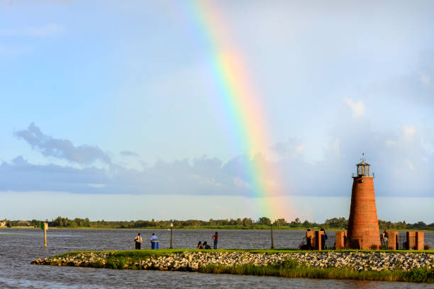 just after the storm a rainbow appeared - kissimmee stock photos and pictures