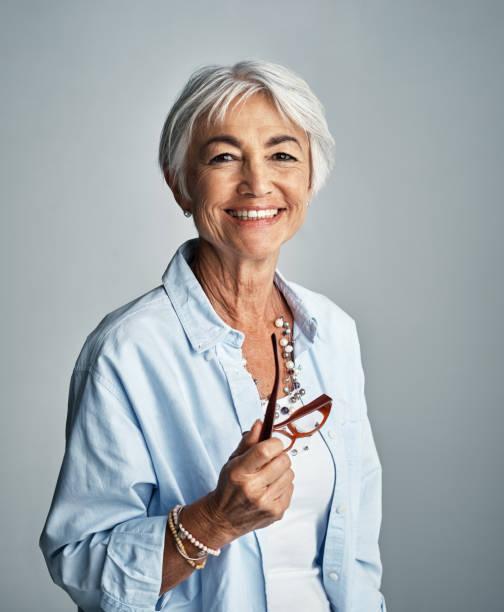 bara vara säker och nöjd med allt som kommer din väg - mature women studio grey hair bildbanksfoton och bilder