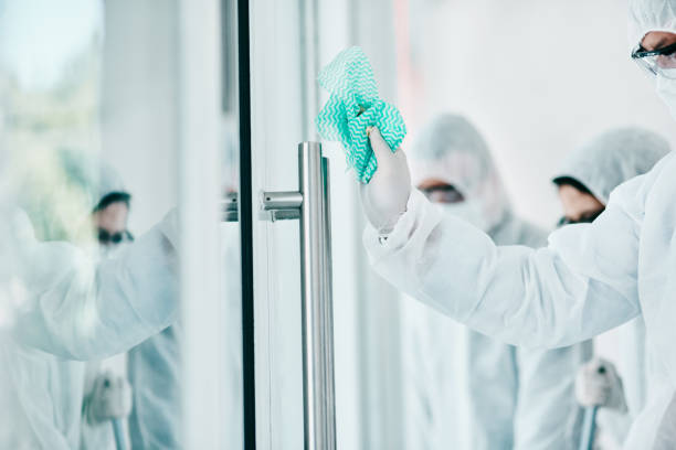 Just because it's invisible doesn't mean it's not there Shot of healthcare workers wearing hazmat suits and sanitising a room during an outbreak decontamination stock pictures, royalty-free photos & images
