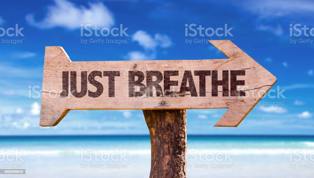 Just Breathe directional sign stock photo