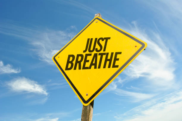 just breathe - breathing exercise stock pictures, royalty-free photos & images