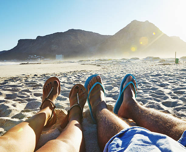 just chillin' - woman leg beach pov stock photos and pictures