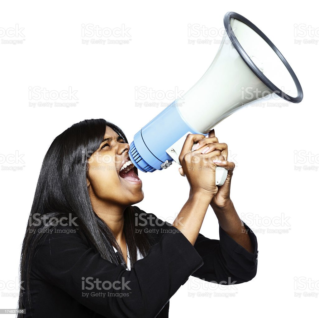 Just do it! Enthusiastic woman yells into megaphone royalty-free stock photo