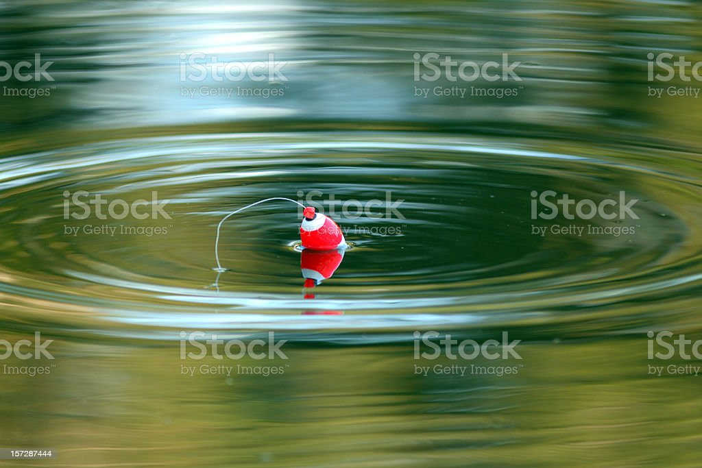 Just Fishing - Cork Floating on Calm Lake stock photo