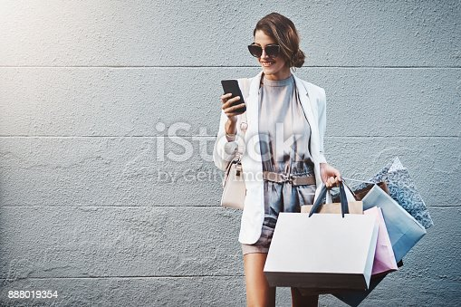Shot of a gorgeous and elegant young woman out on a shopping spree