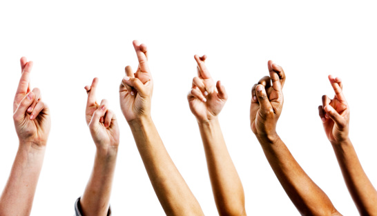 istock Just in case! Six hands with crossed fingers for protection 168252405