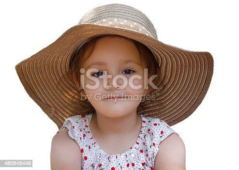 A small girl with a big hat. Isolated on white.