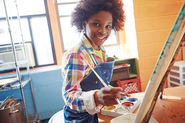 I just love to paint Portrait of a young schoolgirl in an art class pre adolescent child stock pictures, royalty-free photos & images