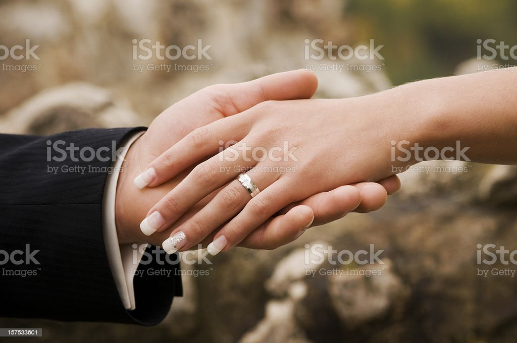 Just Married - Close-up of Bride & Groom Holding Hands stock photo